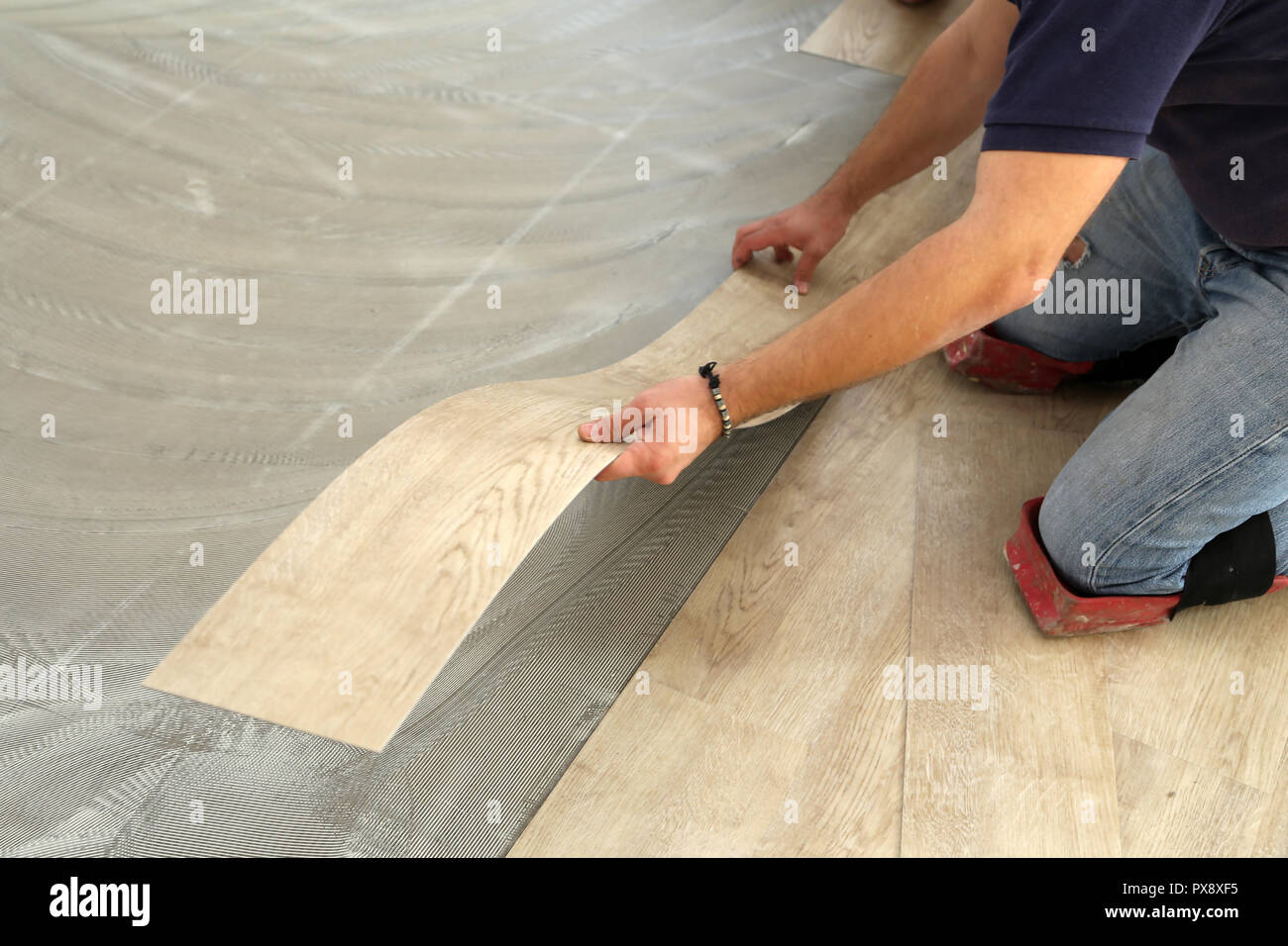 Installing Vinyl Tile Worker Installing New Vinyl Tile Floor Stock Photo 222701897 Alamy