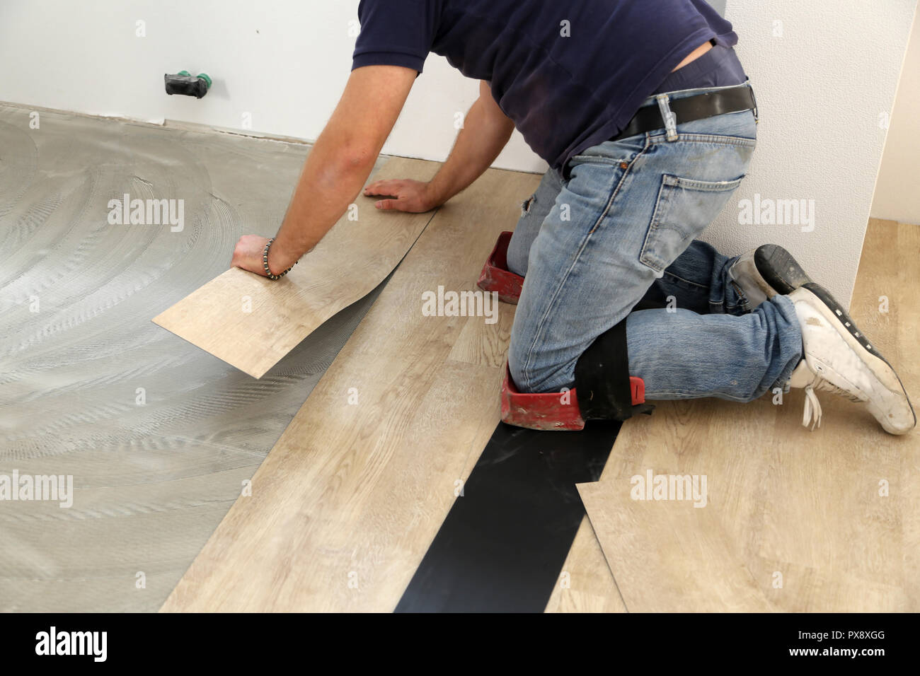 Installing Vinyl Tile Worker Installing New Vinyl Tile Floor Stock Photo 222701936 Alamy