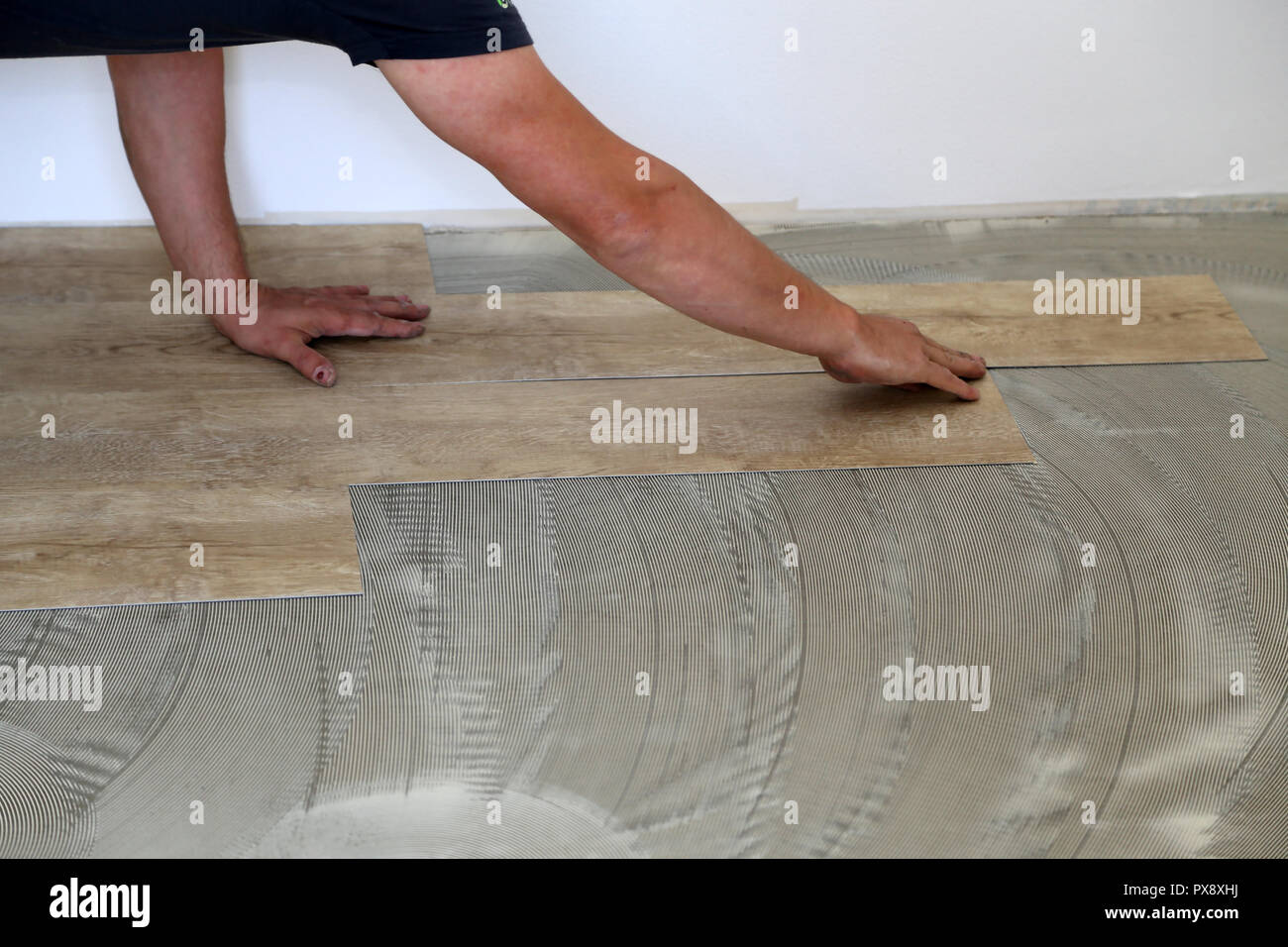 Installing Vinyl Tile Worker Installing New Vinyl Tile Floor Stock Photo 222701966 Alamy