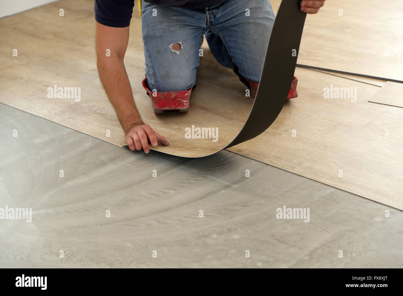 Installing Vinyl Tile Worker Installing New Vinyl Tile Floor Stock Photo 222702000 Alamy