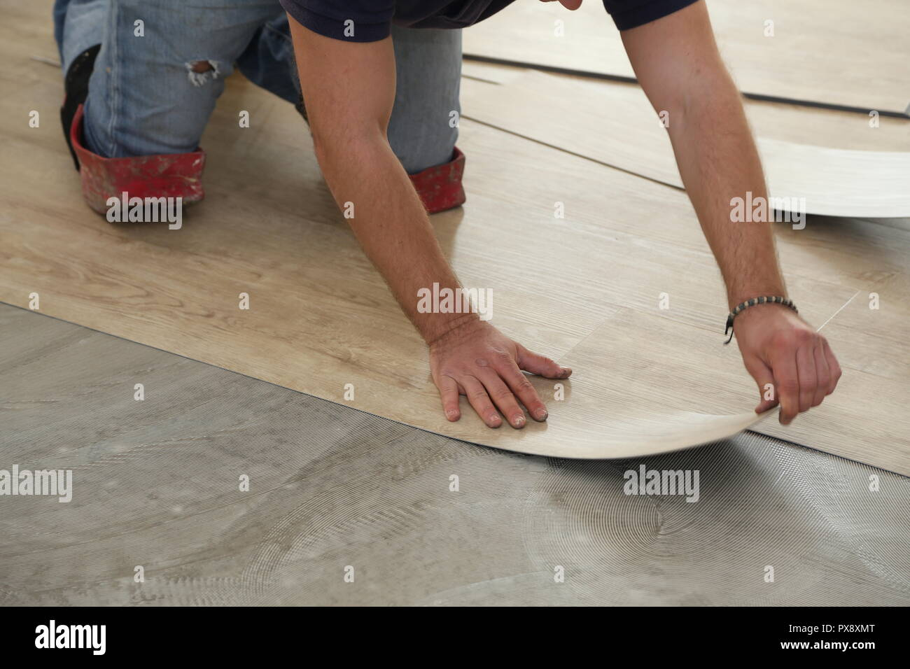 Installing Vinyl Tile Worker Installing New Vinyl Tile Floor Stock Photo 222702056 Alamy