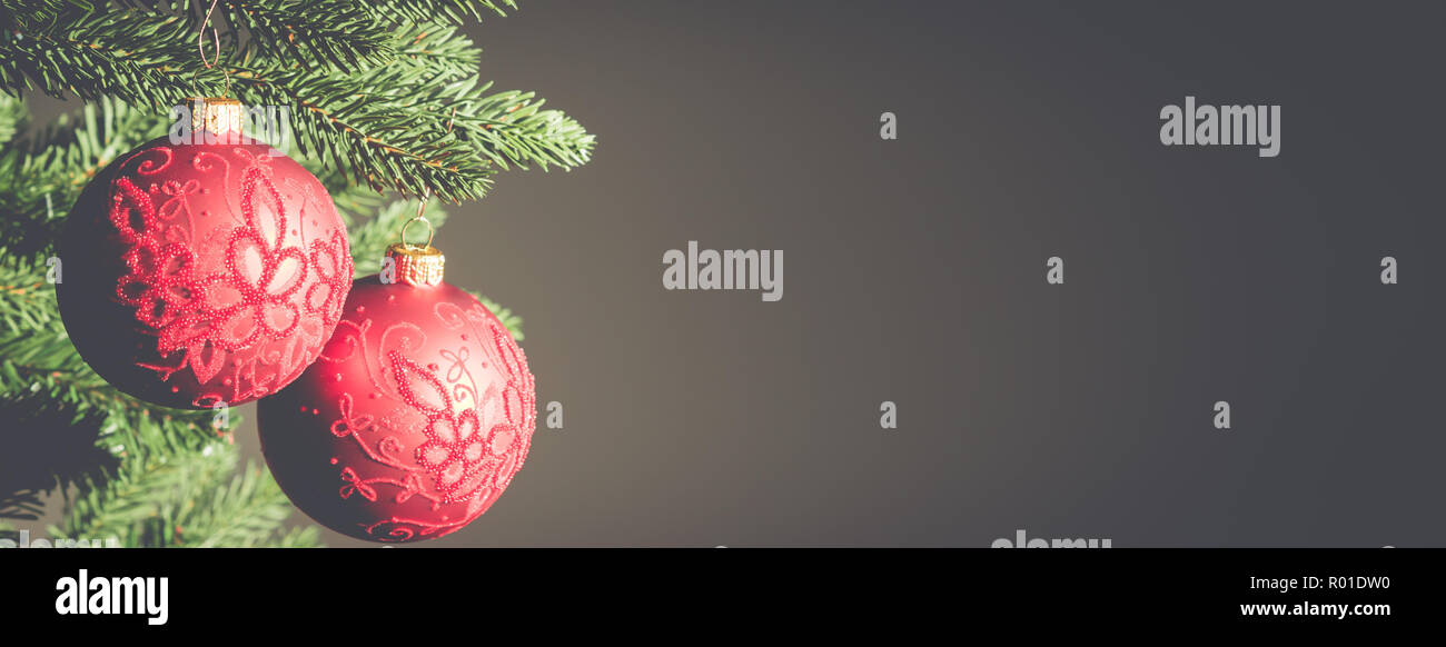 Christmas background banner Close-up of red festive balls hanging