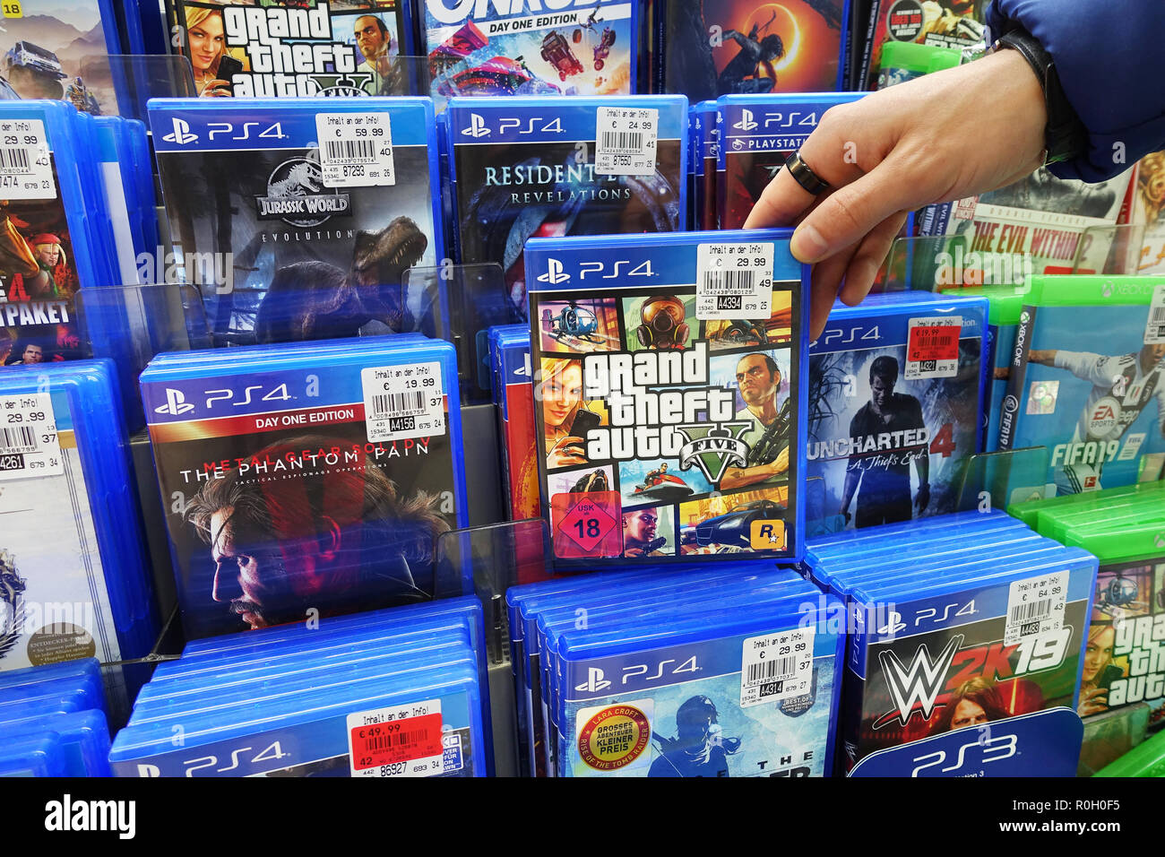 Tiendas Games Store Display Filled With Playstation 4 Games For A Home Video