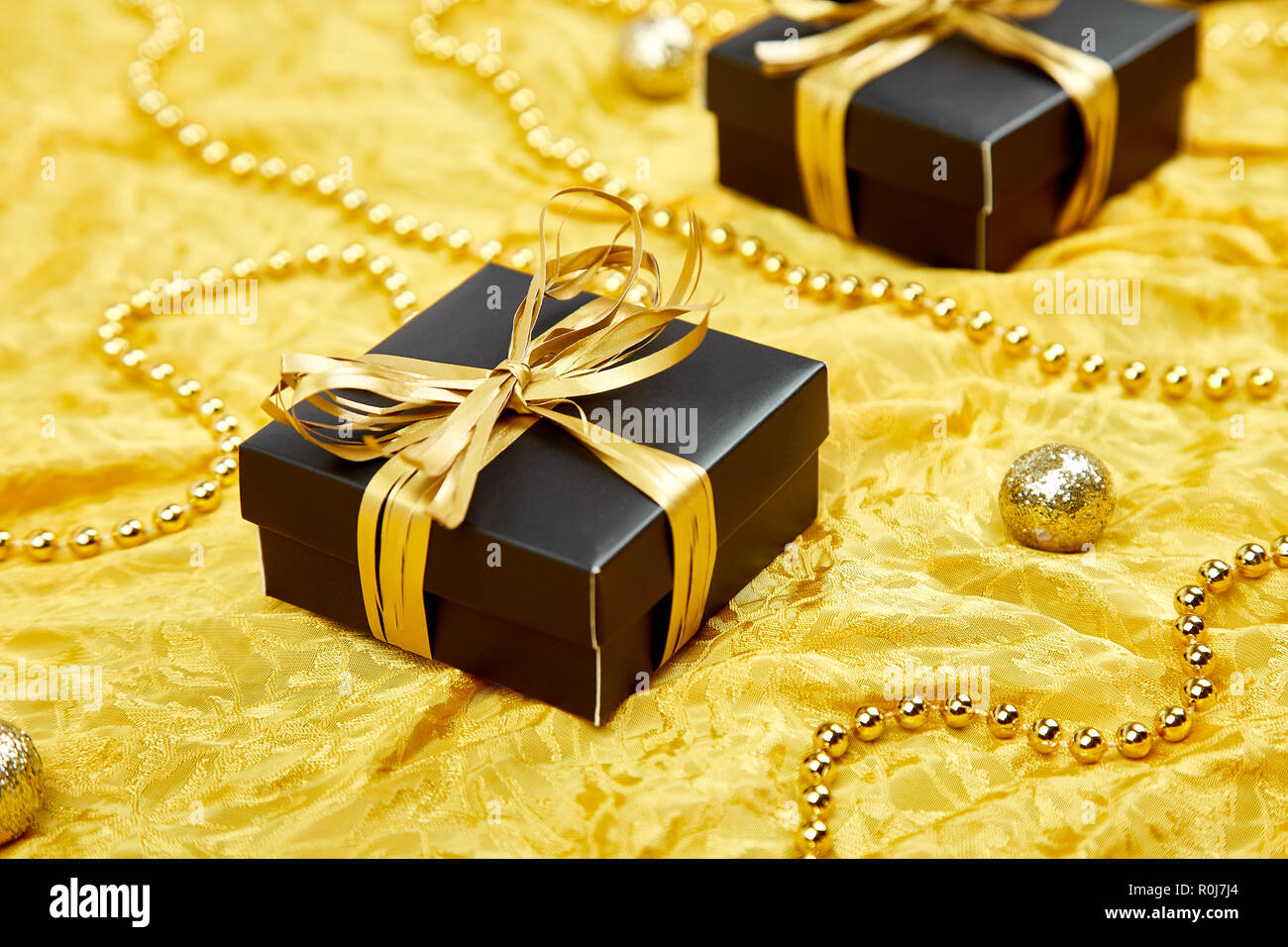 Black Gift Boxes Luxury Black Gift Boxes With Gold Ribbon On Shine Gold Background
