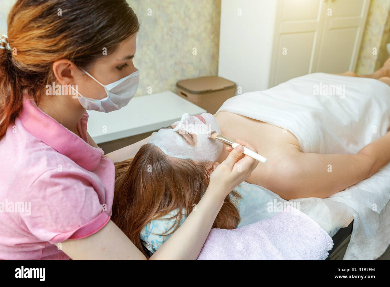 Salon Creme Close Up Of Young Beauty Brunette Woman Getting Face Treatment