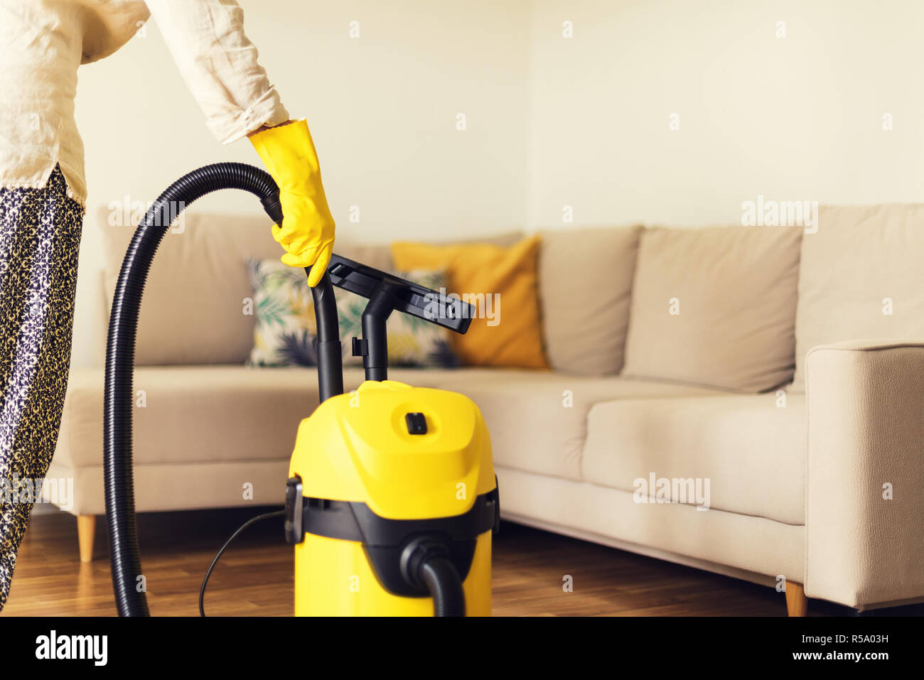 Sofa Service Woman Cleaning Sofa With Yellow Vacuum Cleaner Copy Space