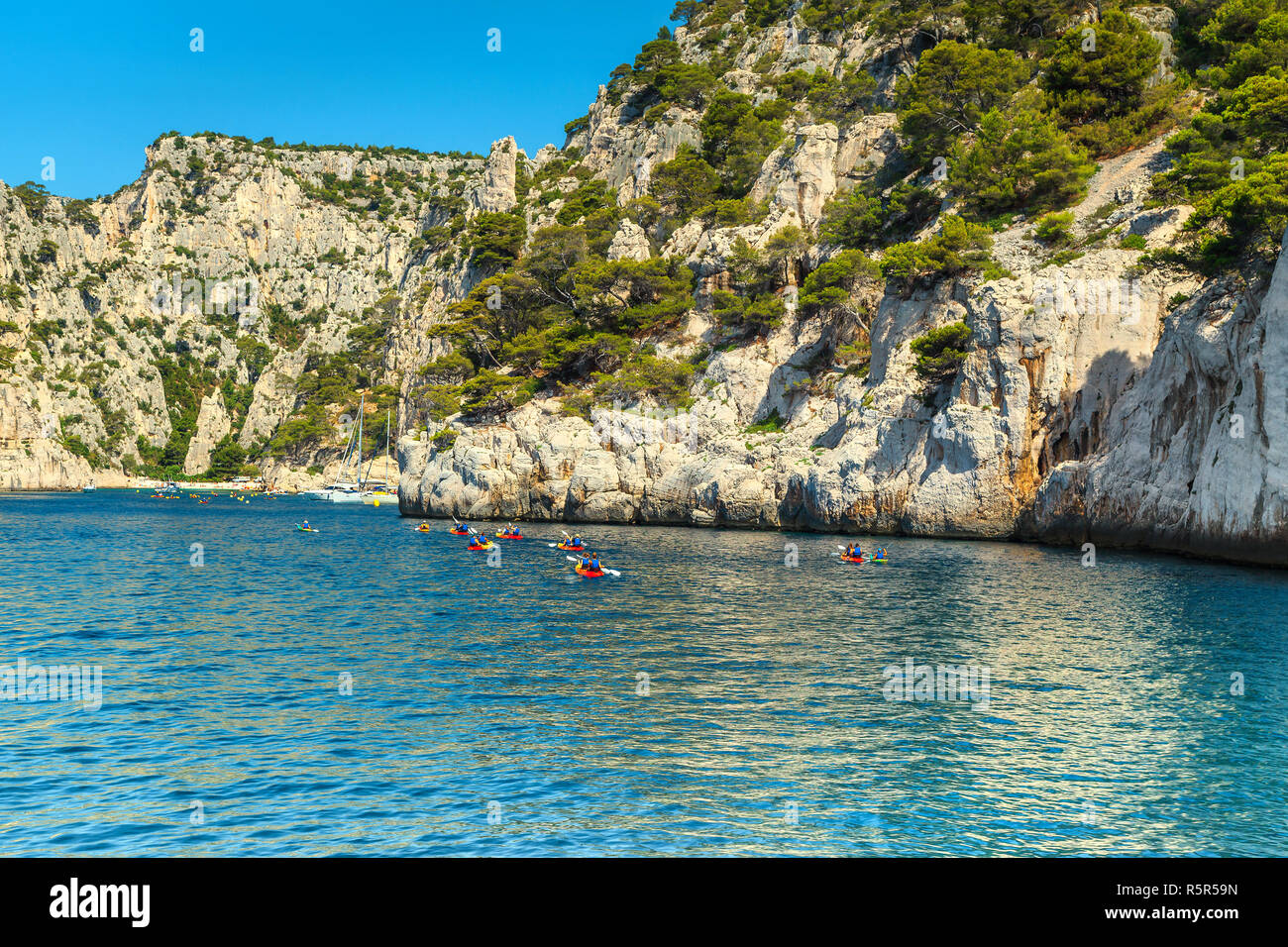 Location Canoe Cassis Summer Outdoor Activities Group Of Kayakers Paddling In Colorful