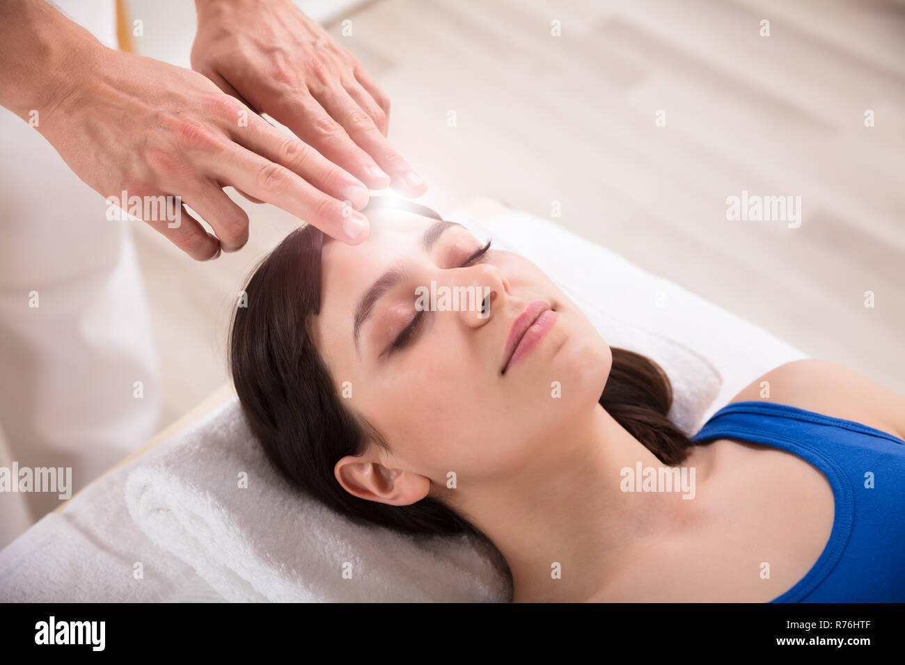 Healing Treatment Therapist Performing Reiki Healing Treatment On Woman Stock Photo