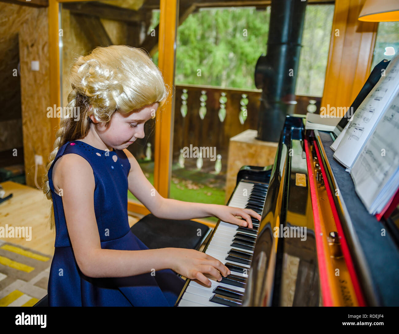 Dressing A Composer Cute Little Girl Playing Piano Dressing In Retro Mozart Periwig