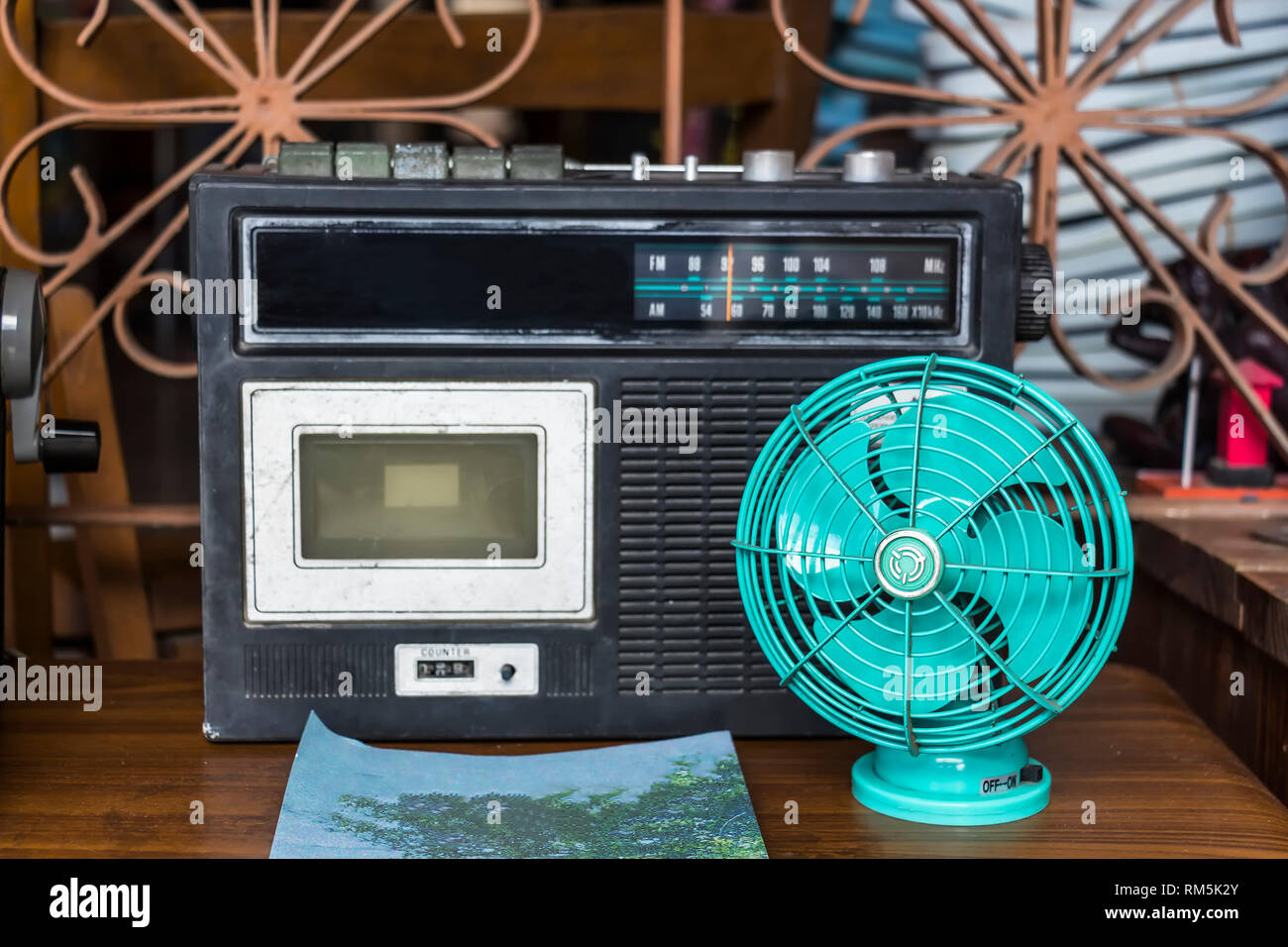 Vintage Looking Fan Small Vintage Looking Table Fan And Retro Cassette Player Stock