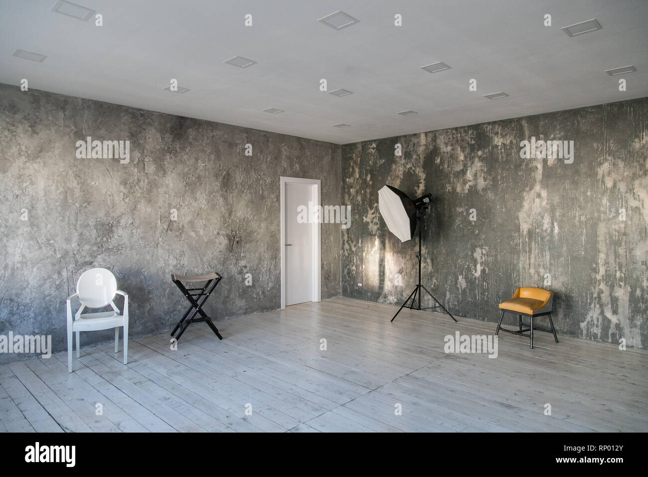 Light Wood Floors Gray Walls Modern Light Loft Style Room With Designer Chairs And Lighting