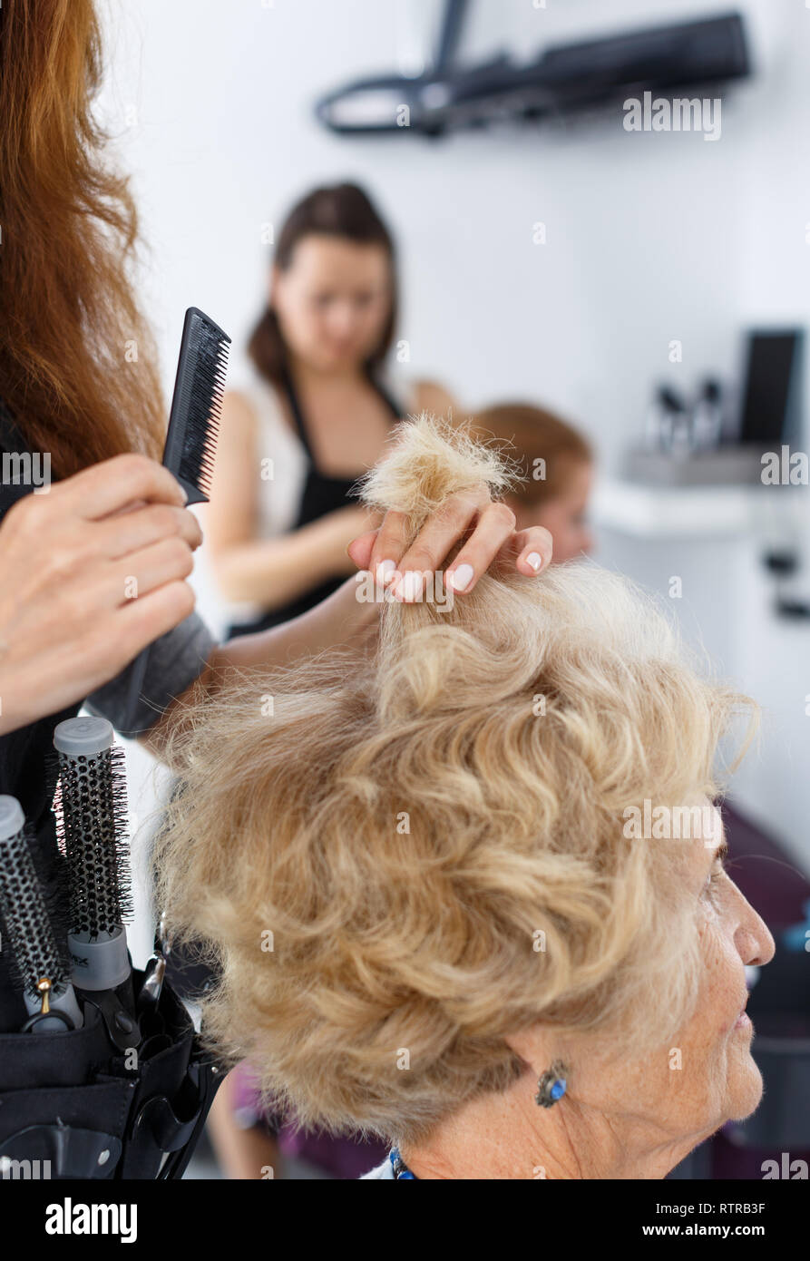 Salon Senior Closeup Of Senior Woman Getting Haircut By Professional