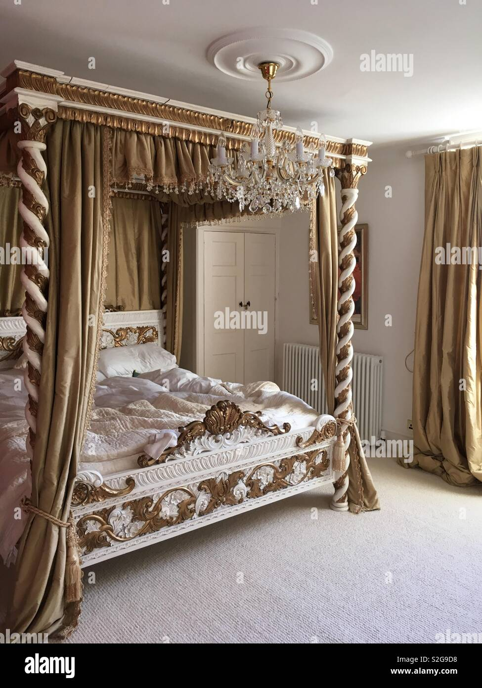 Emperor Bed A Gold Four Poster Emperor Bed Made From Carved Wood Stock Photo