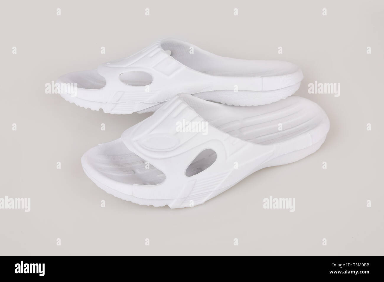 Baby Hotel Slippers Pair Of Blank White Home Slippers Top And Bottom View Bed