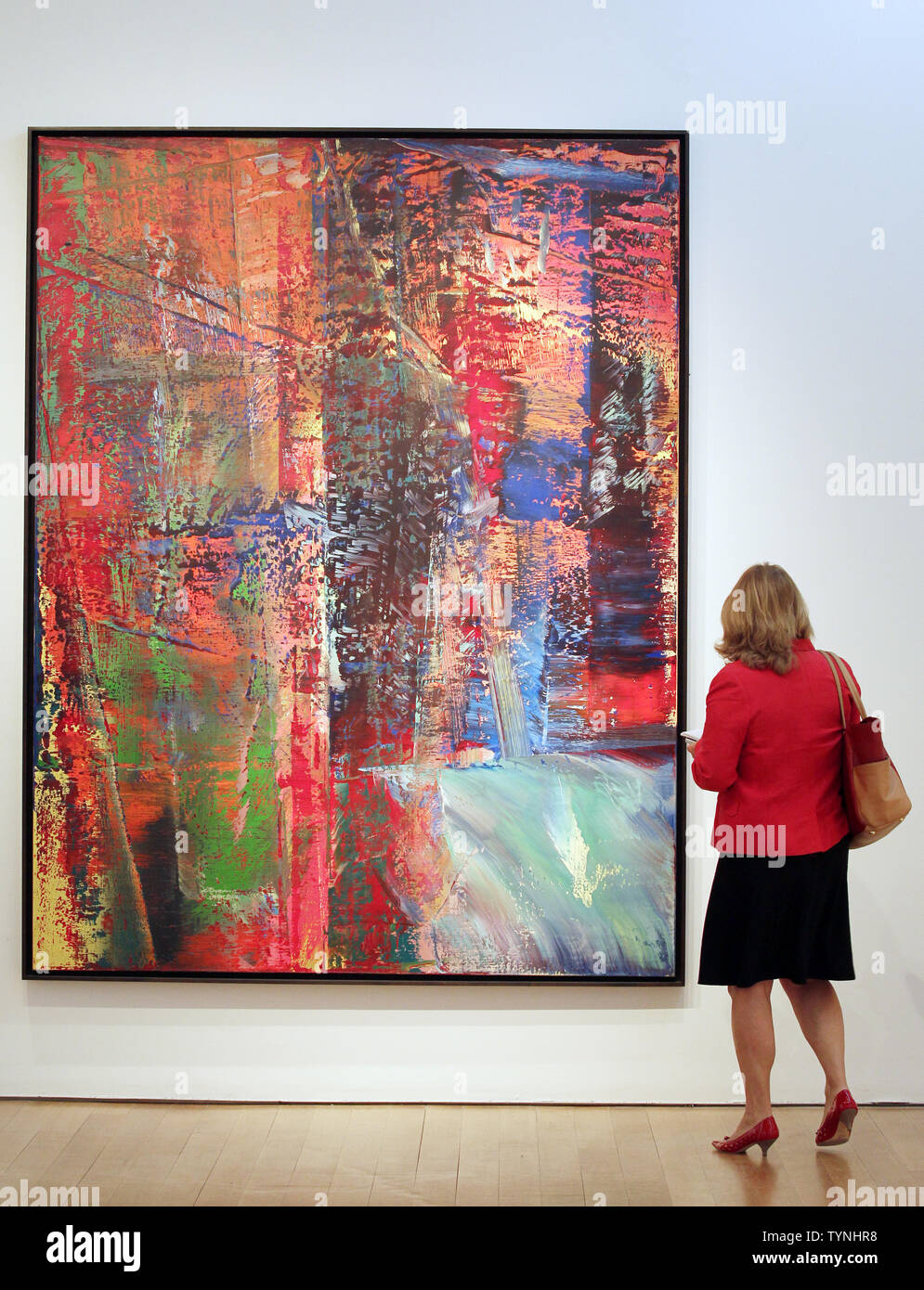 A Woman Looks At A Painting By Artist Gerhard Richter Titled Abstraktes Bild Dunkel During A Preview Of A Post War And Contemporary Art Auction At Christie S In New York City On May