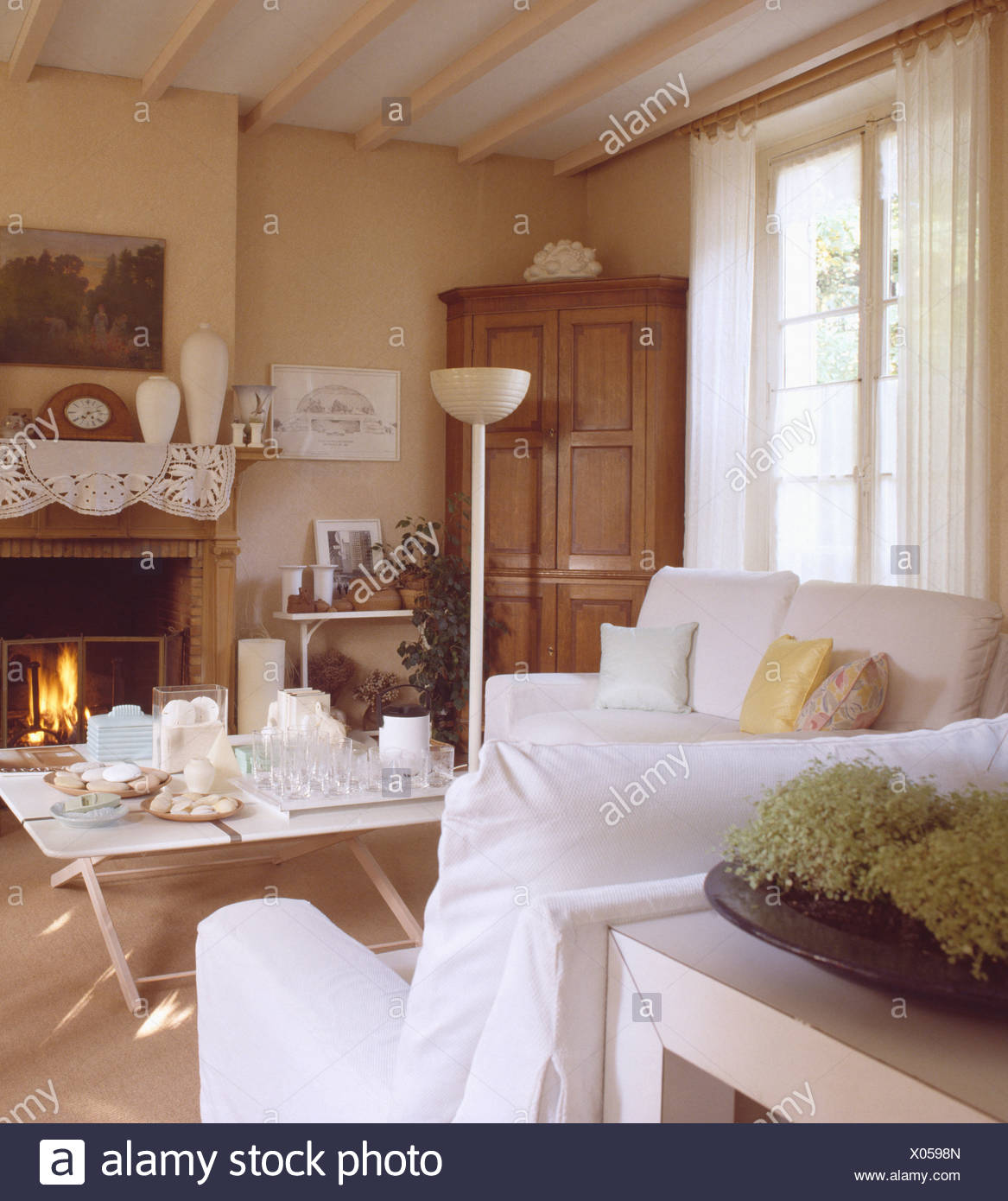 French Country Fireplace White Loosecovers On Sofas In Neutral French Country Living Room