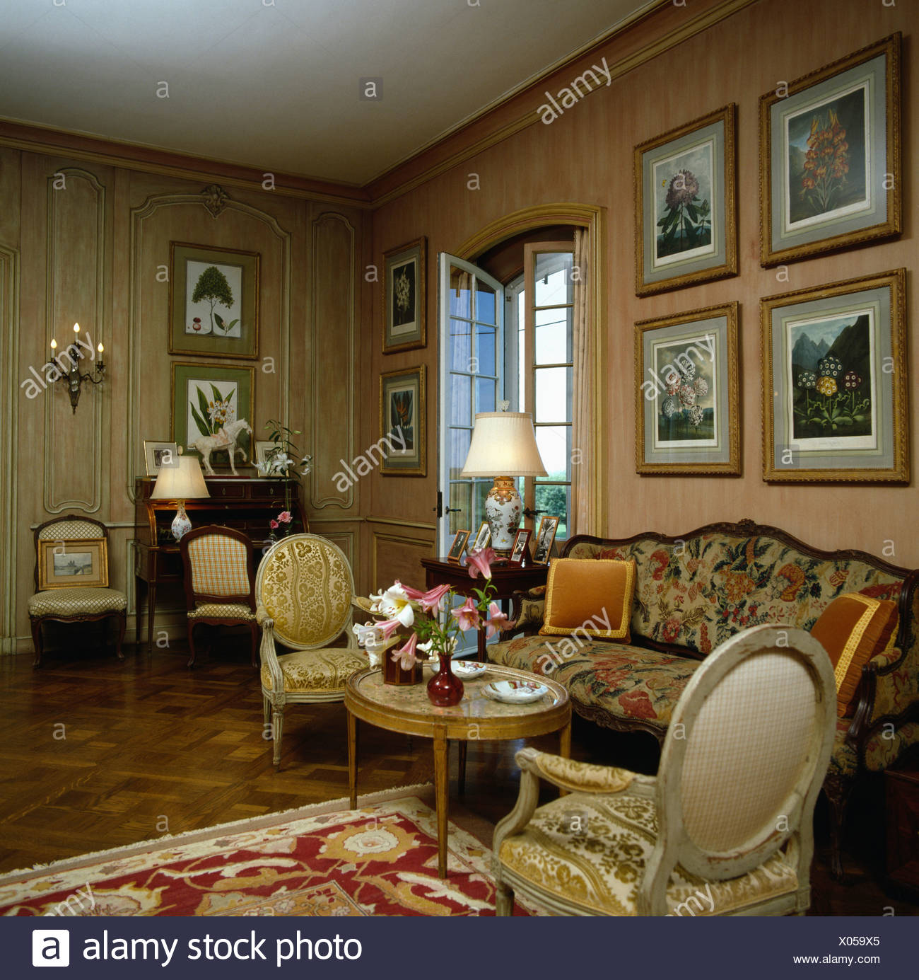 Drawing Room Furniture Pictures On Wall Above Patterned Sofa In Drawing Room With French