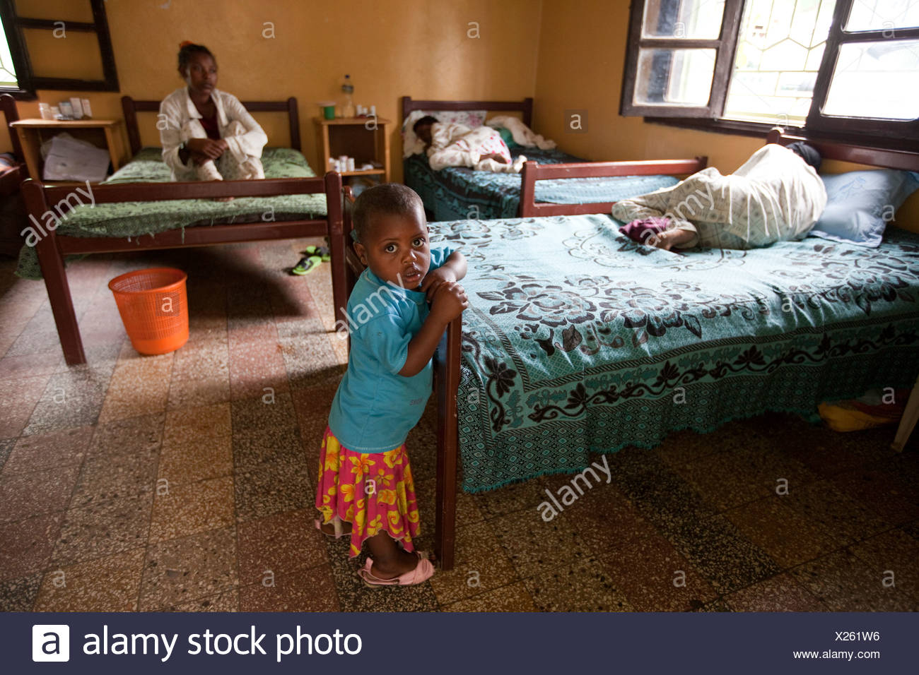 Bed Aids A Girl Stands By Her Mother S Bed In The Dawn Of Hope Aids