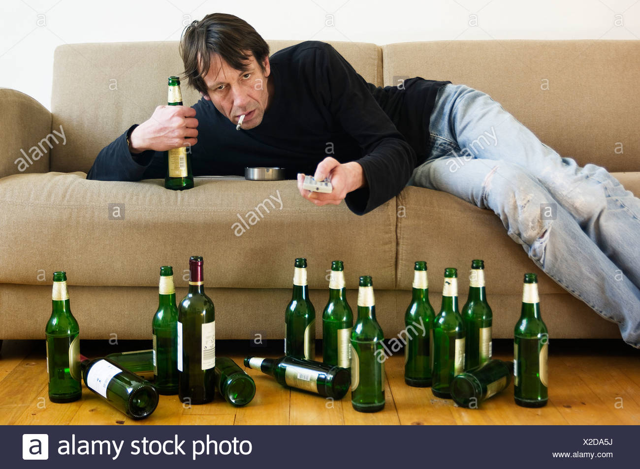Sofa Frankfurt Germany Hessen Frankfurt Drunk Man Lying On Sofa With Empty