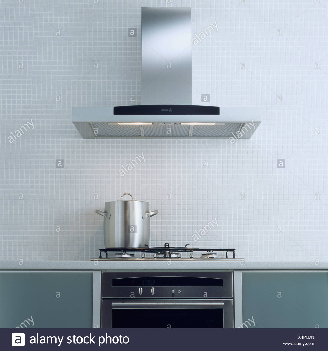 Stainless Steel Extractor Fan Above Pan On Hob In Modern Kitchen Stock Photo Alamy