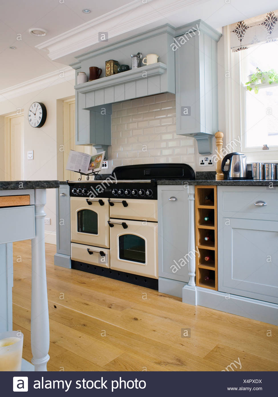 Pale Blue Kitchen Cream Range Oven In Kitchen With Pale Blue Fitted Units And Wooden