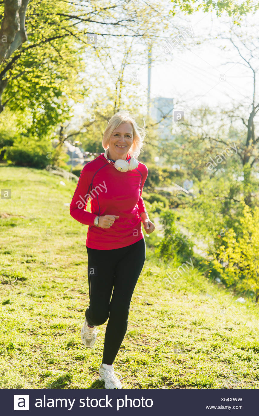 Fitness Mannheim Germany Mannheim Mature Woman Jogging In Park Stock Photo