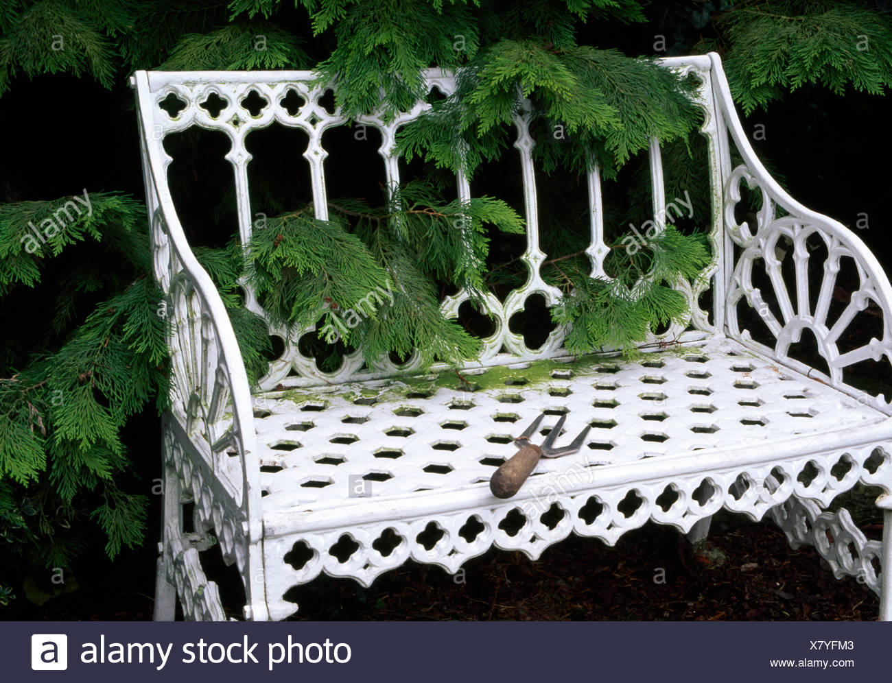 Small Garden Bench Small Garden Fork On A White Wrought Iron Garden Bench In Front Of