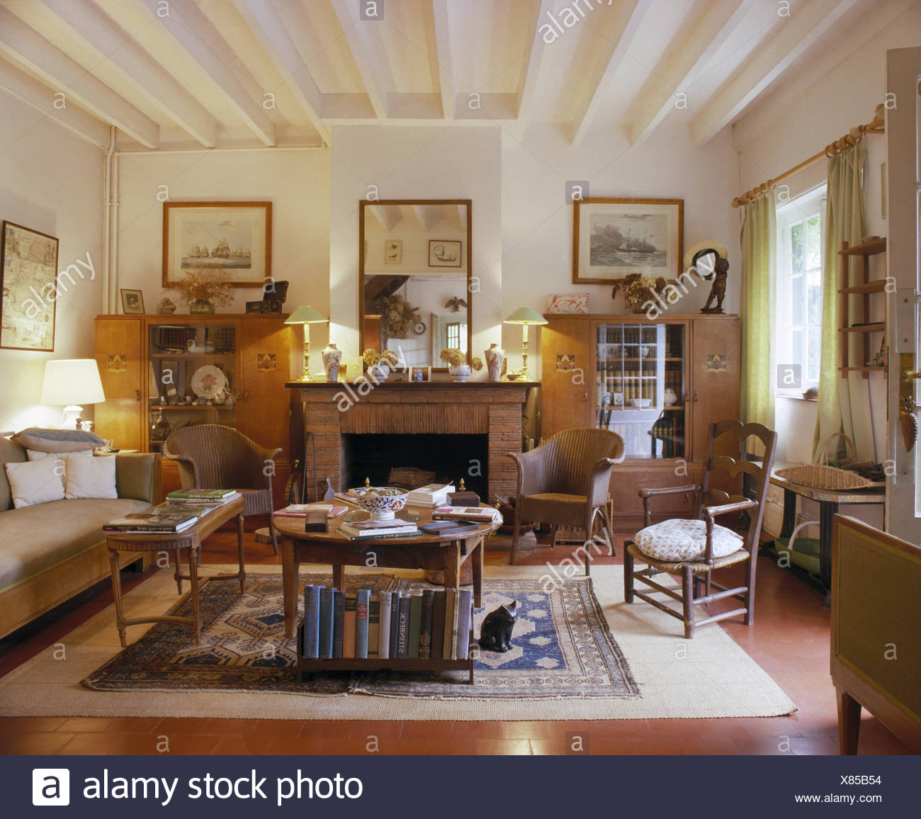 Living Room In French Lloyd Loom Chairs And Comfortable Sofa In French Country Living
