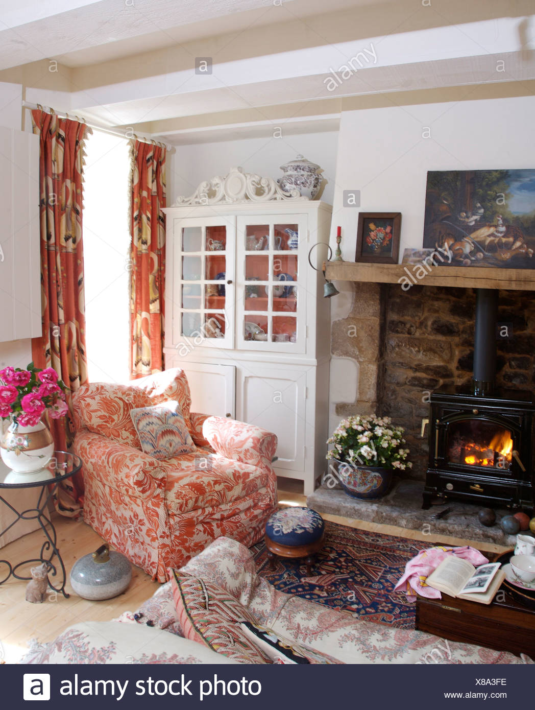 French Country Fireplace Pink White Armchair Beside Fireplace With Wood Burning Stove In