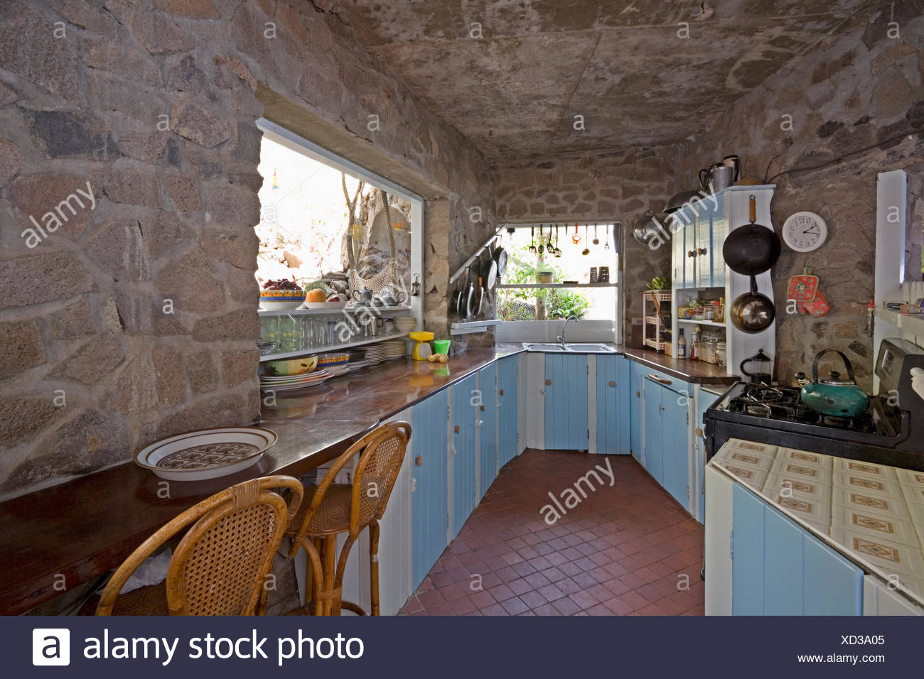 Cucina Interior Design Rustic Pale Blue Cupboards In Rustic Caribbean Kitchen With Stone Walls