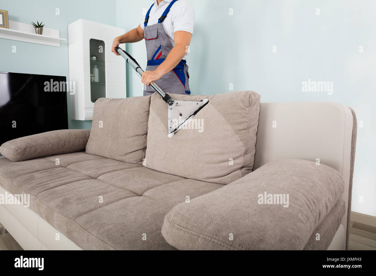 Sofa Reinigen Jeans People Vacuuming Young Stockfotos And People Vacuuming Young