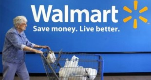 8621-a-customer-leaves-a-wal-mart-store-in-rogers-arkansas-june-4