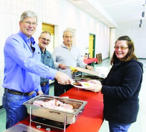 Mayfield United Church hosted their annual Pancake Supper at the Brampton Fairgrounds. Philip Armstrong, Ian Armstrong and Bob Persant were serving Heather Reid Smith her dinner.
