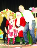 HERB CAMPBELL HOSTS SANTA Saturday was the time for the annual Breakfast with Santa at Herb Campbell Public School. the gust of honour got the chance to meet many of his friends, including Grade 2 student Alexandra Fannon, who was accompanied by her parents Nancy and Ted. Photo by Bill Rea