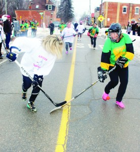 The first game in the tournament featured women going at it on the pavement. Group Therapy in the white jerseys, made up of women from Alton were taking on representatives from Erin Public School in green. The Alton side won 8-6.