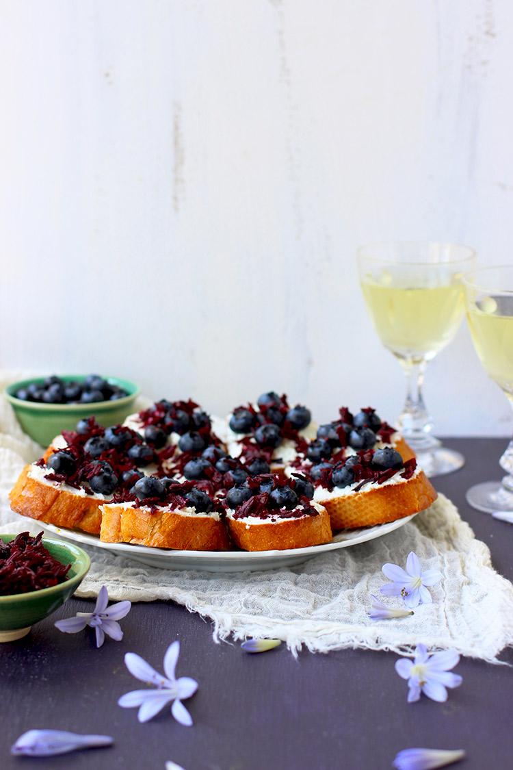 Blueberry chevre crostini with champagne vinegar hibiscus flowers blueberry chevre crostini izmirmasajfo