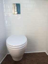 Wall mounted toilet with water tank concealed inside wall ...