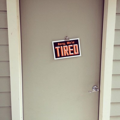 sorry we are tired sign