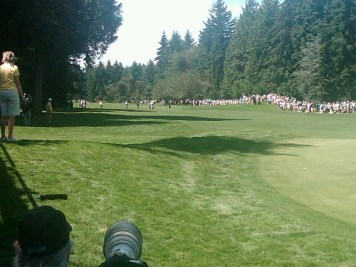 Crowds line the fairway as Adam Hadwin hits his approach on the 18th hole at the RBC Canadian Open.