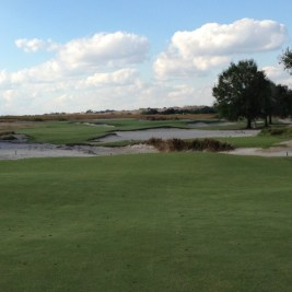 The heavily bunkered par 3 10th at Blue.