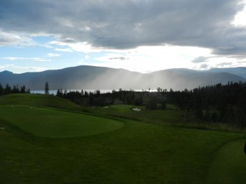 The fifth hole with the sun hiding behind the clouds.