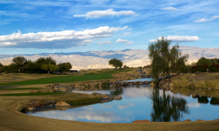 Looking down over the water hazard that protects the right side of the 382 yard Par 18th