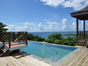 The refreshing pool, with a wrap around deck, gazebo and the gorgeous view beyond.