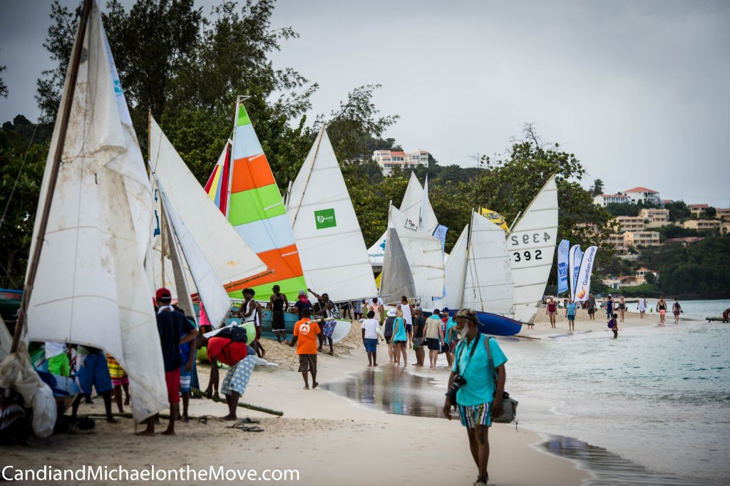The work boats are rigged and line the beach waiting to be called for their village race. there is tremendous competition between the fishing villages for the distinction of Champion of Champions.
