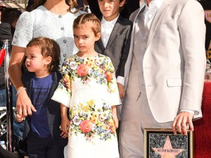 Matthew McConaughey, wife Camila, children Levi, Vida (in Dolce & Gabbana dress) and Livingston pose on the red carpet as Matthew received his star on the Hollywood Walk of Fame on Monday, November 17th. Image courtesy of People. Photo credit: Jason Merritt/Getty