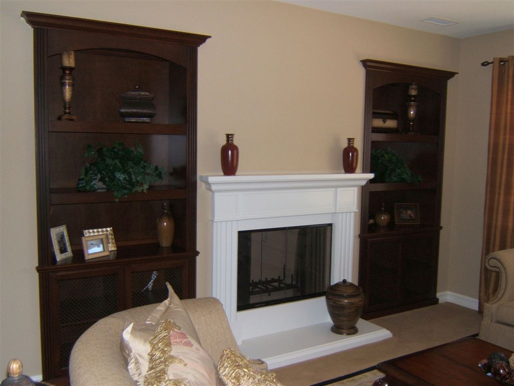 Custom Home Builders In Los Angeles Custom Cabinetry Built Into Niches Next To Fireplace. | C