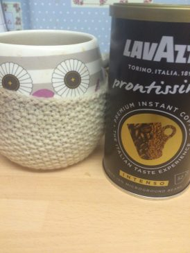 lavazza coffee, coffee in an owl cup, owl cup with warmer, lavazza coffee at home