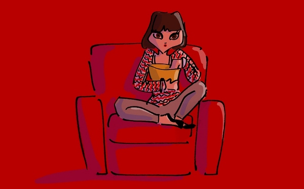 Girl eats popcorn and watches a movie at !f Istanbul film festival