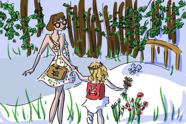 Girl and her daughter walk in the woods with their Grav Grav bags