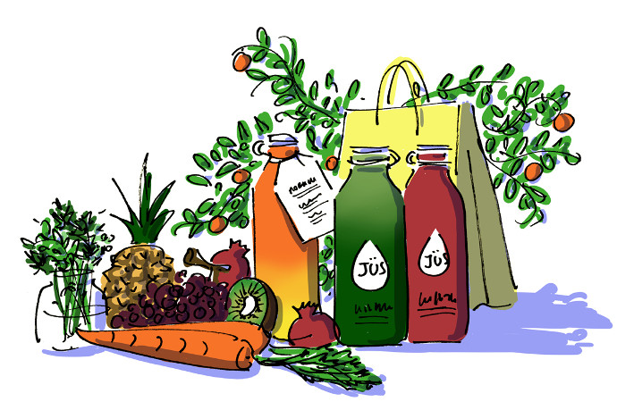JÜS bottles of cold-pressed juice made of fresh vegetables